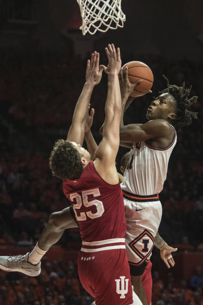 Illinois' Ayo Dosunmu (11) goes up to shoot as Indiana's Race Thompson (25) defends in the first half of an NCAA college basketball game Sunday, March 1, 2020, in Champaign, Ill. (AP Photo/Holly Hart)