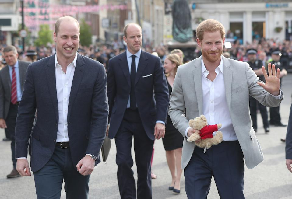 WINDSOR, ENGLAND - MAY 18: (L-R) Prince William, Duke of Cambridge and Prince Harry greet members of the public as they embark on a walkabout ahead of the royal wedding of Prince Harry and Meghan Markle on May 18, 2018 in Windsor, England. (Photo by Jonathan Brady - Pool/Getty Images)