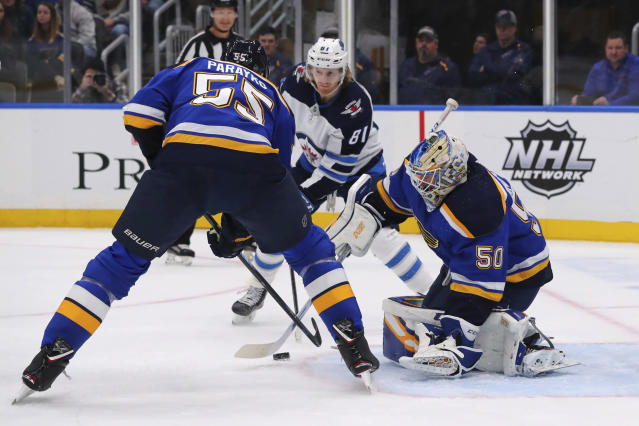 St. Louis Blues goalie Jordan Binnington (50) makes a save against the Winnipeg Jets during the first period of an NHL hockey game Sunday, Dec. 29, 2019, in St. Louis. (AP Photo/Dilip Vishwanat)