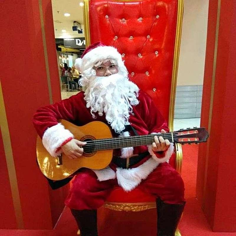 During performances as Santa in previous years, Yap would use musical instruments to enhance his Santa character. — Picture courtesy of Alex Yap