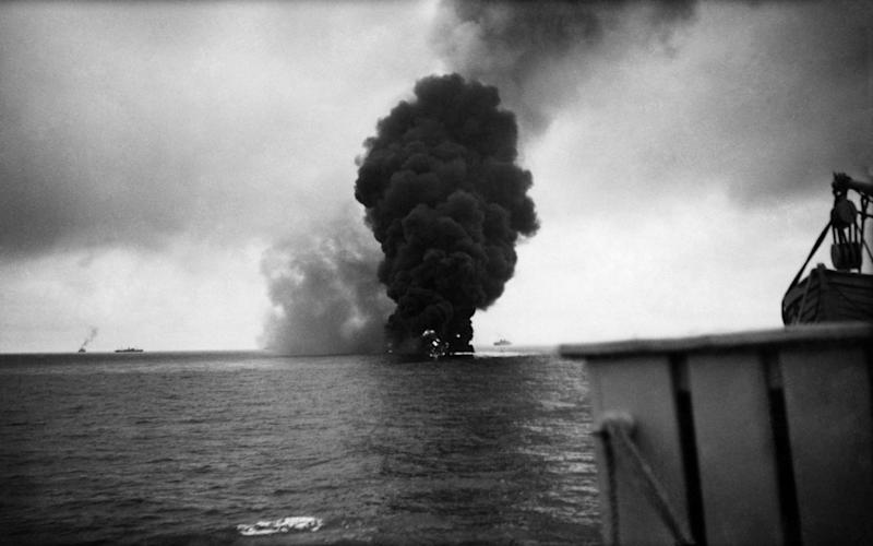 An oil tanker ablaze after being torpedoed in 1940 - Getty