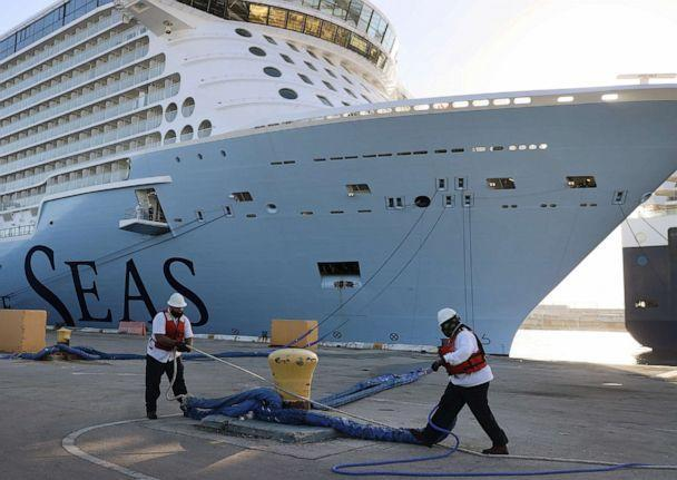 PHOTO: Dock workers use ropes to tie Royal Caribbean's Odyssey of the Seas to its berthing spot at Port Everglades on June 10, 2021, in Fort Lauderdale, Fla. (Joe Raedle/Getty Images)