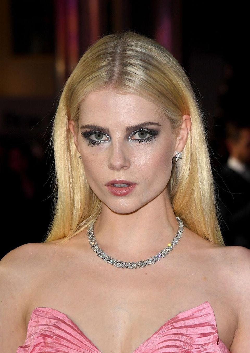<p>Messy metallic eyeshadow and all of the lashes gave Lucy Boynton's pink Gucci dress a grungey twist. </p>