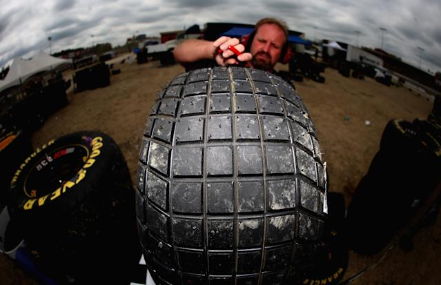 ROSSBURG, OH - JULY 24: Crew members prepare their Goodyear Racing tire, made for dirt track racing, during practice for the NASCAR Camping World Truck Series inaugural Mudsummer Classic at Eldora Speedway on July 24, 2013 in Rossburg, Ohio. (Photo by Tom Pennington/Getty Images)
