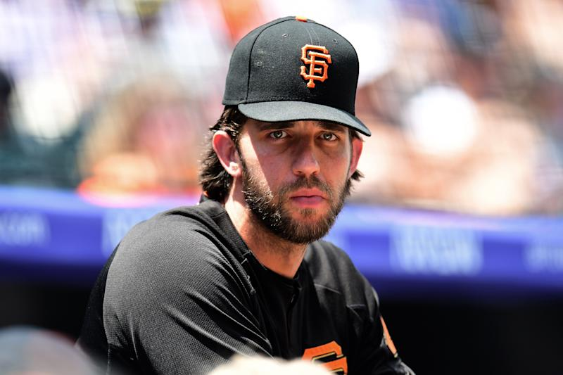 San Francisco Giants starting pitcher Madison Bumgarner (40) looks on during the first inning against the Colorado Rockies at Coors Field. (Ron Chenoy-USA TODAY Sports)