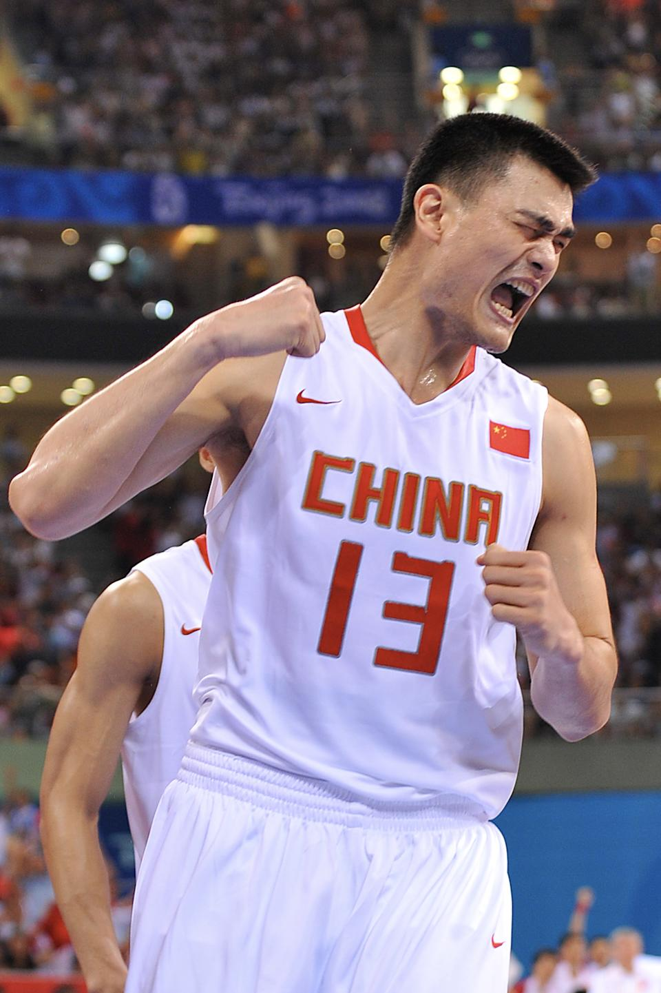 BEIJING - AUGUST 12: Yao Ming #13 of China celebrates against Spain during day 4 of the men's preliminary basketball game at the 2008 Beijing Olympic Games at the Beijing Olympic Basketball gymnasium on August 12, 2008 in Beijing, China. NOTE TO USER: User expressly acknowledges and agrees that, by downloading and/or using this Photograph, user is consenting to the terms and conditions of the Getty Images License Agreement. Mandatory Copyright Notice: Copyright 2008 NBAE (Photo by Garrett Ellwood/NBAE via Getty Images)