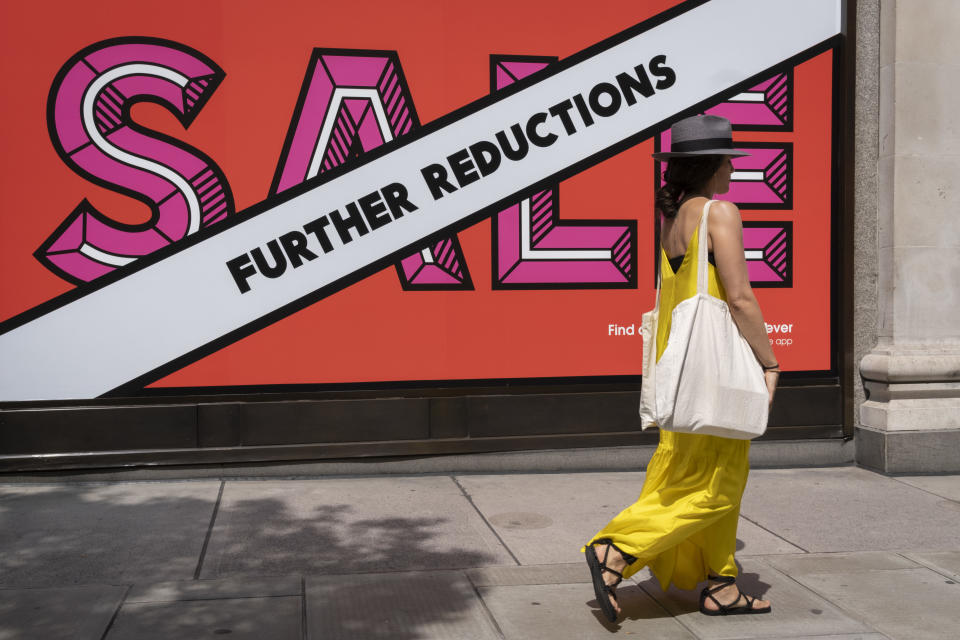 A shopper walks past Selfridges whose Summer Sale is advertised in their window banners on Oxford Street in the West End on Covid 'Freedom Day'. This date is what Prime Minister Boris Johnson's UK government has set as the end of strict Covid pandemic social distancing conditions with the end of mandatory face coverings in shops and public transport, on 19th July 2021, in London, England. (Photo by Richard Baker / In Pictures via Getty Images)