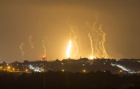 The Israeli community of Netiv Haasara is seen in front of flares fired by the Israeli army in Gaza July 23, 2014. REUTERS/Amir Cohen
