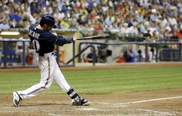 Milwaukee Brewers' Jonathan Lucroy hits a walk off home run during the ninth inning of a baseball game against the Cincinnati Reds, Tuesday, July 22, 2014, in Milwaukee. The Brewers won 4-3. (AP Photo/Morry Gash)