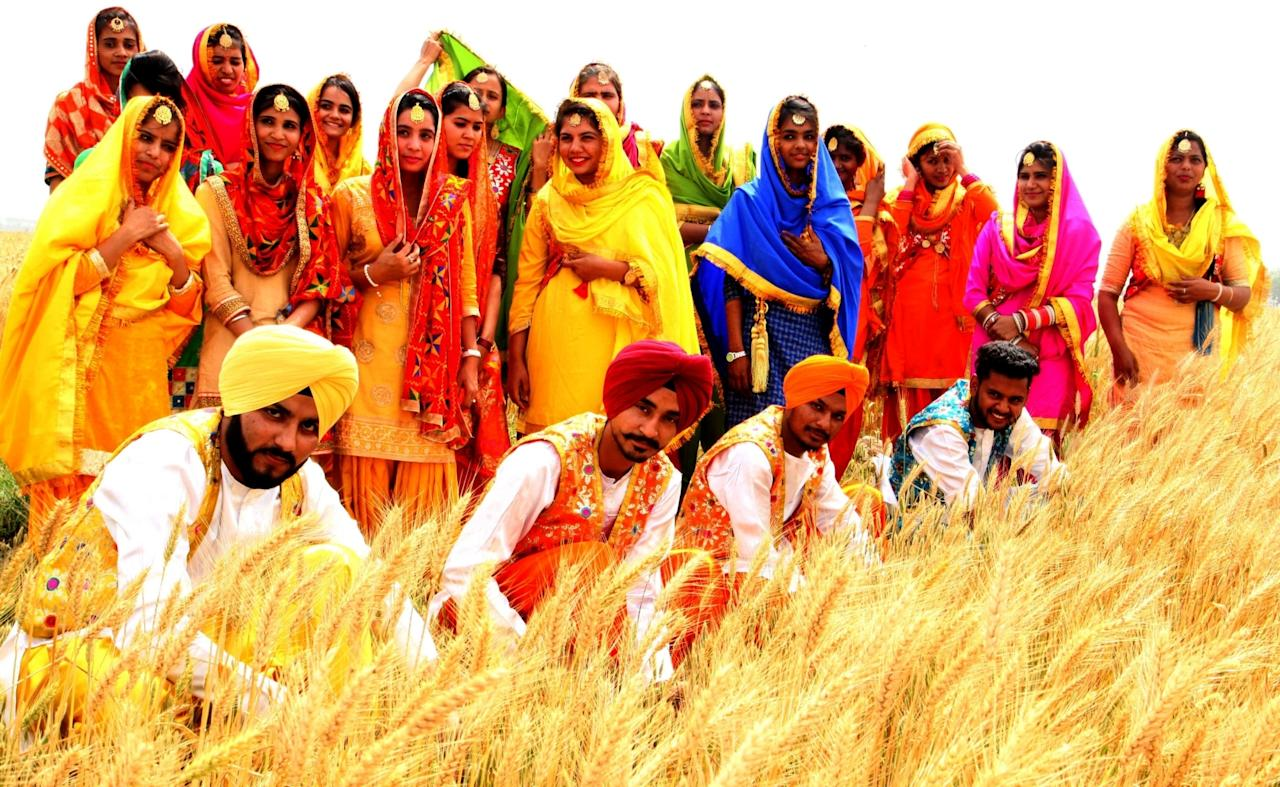 <p>Students perform Bhangra as they celebrate Vaisakhi in wheat fields on the outskirts of Chandigarh on April 6, 2017. (Photo: IANS) </p>