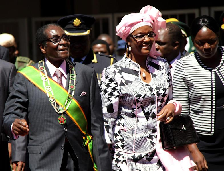 "Zimbabwe President Robert Mugabe, left, and his wife Grace, arrive for celebrations to mark 32 years of independence of Zimbabwe, in Harare, Wednesday, April 18, 2012. In an address Mugabe said that political violence must be ""buried in the past"" to move the nation toward free and unhindered elections. (AP Photo)"