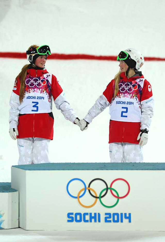 Chloe and Justine Dufour-Lapointe celebrate their silver and gold medals, respectively, in Sochi during the 2014 Winter Olympics. (Getty Images)