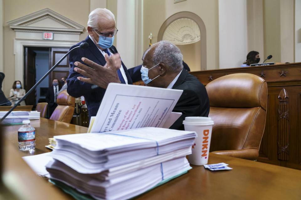 Rep. Bill Pascrell, D-N.J., left, and Rep. Danny Davis, D-Ill., confer as the tax-writing House Ways and Means Committee continues working on a sweeping proposal for tax hikes on big corporations and the wealthy to fund President Joe Biden's $3.5 trillion domestic rebuilding plan, at the Capitol in Washington, Tuesday, Sept. 14, 2021. (AP Photo/J. Scott Applewhite)
