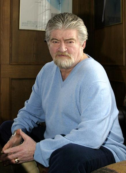 """FILE-This Jan. 30, 2004 file photo shows screenwriter Joe Eszterhas sitting for a photo in his Chagrin Falls, Ohio. The future of a film about the ancient Jewish warrior Judah Maccabee, is uncertain after a disagreement between producer Mel Gibson and screenwriter Eszterhas. Warner Bros. spokesman Paul McGuire said Friday that the studio is """"analyzing what to do with the project."""" (AP Photo/Ron Schwane,File)"""