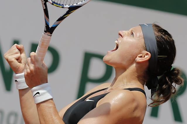 Lucie Safarova of the Czech Republic celebrates winning her third round match of the French Open tennis tournament in two sets, 6-3, 6-3, against Serbia's Ana Ivanovic at the Roland Garros stadium, in Paris, France, Saturday, May 31, 2014. (AP Photo/David Vincent)