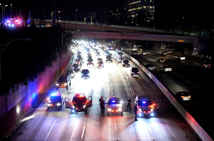 <p>California Highway Patrol officer stop the flow of traffic on the 110 freeway as protesters attempted to rush the freeway, but were unsuccessful, during a march and rally against the election of Republican Donald Trump as President of the United States in Los Angeles, California, U.S. November 11, 2016. (REUTERS/Kevork Djansezian) </p>