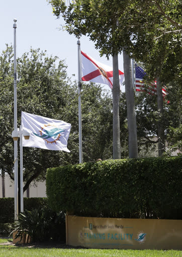 The Miami Dolphins team flag flies at half mast outside the NFL football team's training camp facility, Monday, May 4, 2020, in Davie, Fla. Former Dolphins coach and Hall of Famer Don Shula died Monday at his home in Indian Creek, Fla. He was 90. (AP Photo/Wilfredo Lee)