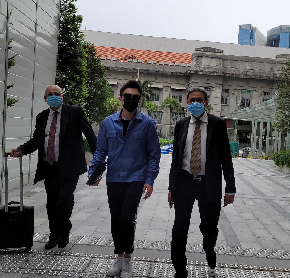 Shane Pow walking into court flanked by his lawyers on 14 July 2021. (PHOTO: Yahoo News Singapore/Wan Ting Koh)