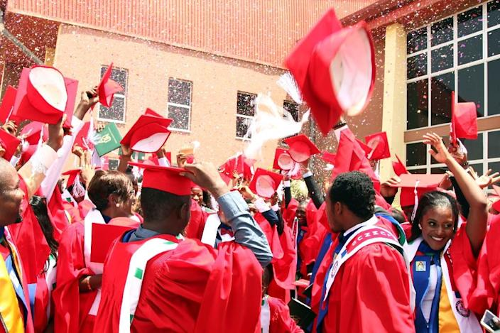 Graduating students of the American University of Nigeria in Yola celebrate after their commencement ceremony at the school on May 9, 2015 (AFP Photo/Emmanuel Arewa )