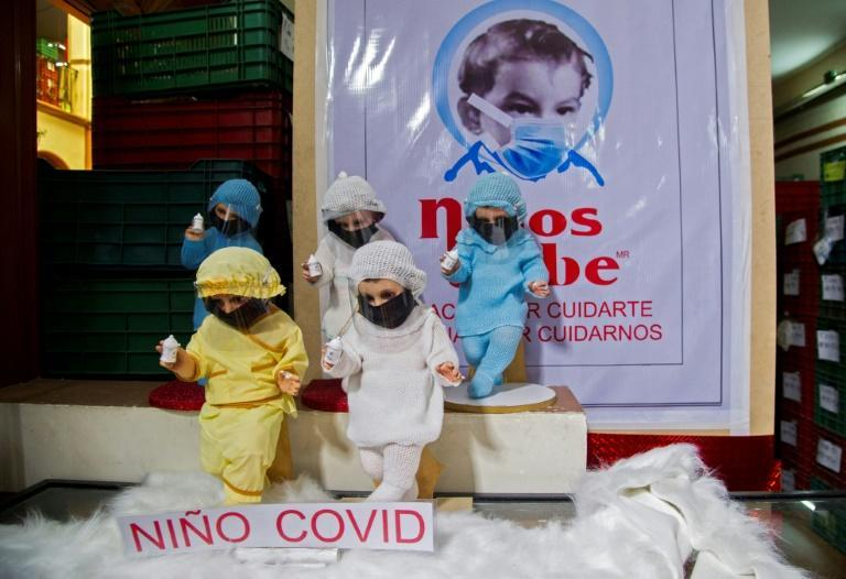 Dolls representing the baby Jesus are being given a Covid-19 theme this year in Mexico