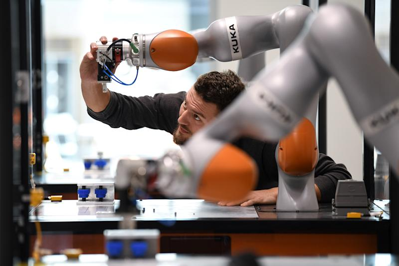Tobias Jakob, an employee of German manufacturer of industrial robots and automation solutions KUKA, poses for pictures at the company's training center in Augsburg, Germany, March 28, 2019. REUTERS/Andreas Gebert