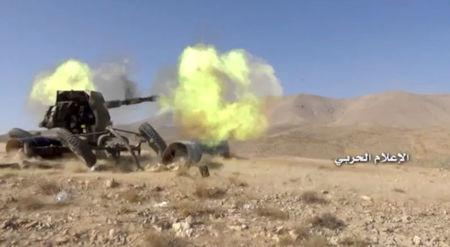 A still image taken on August 19, 2017 from a footage of Hezbollah military handout shows a Hezbollah artillery firing at western Qalamoun, Syria. Hezbollah Military Handout via Reuters TV.