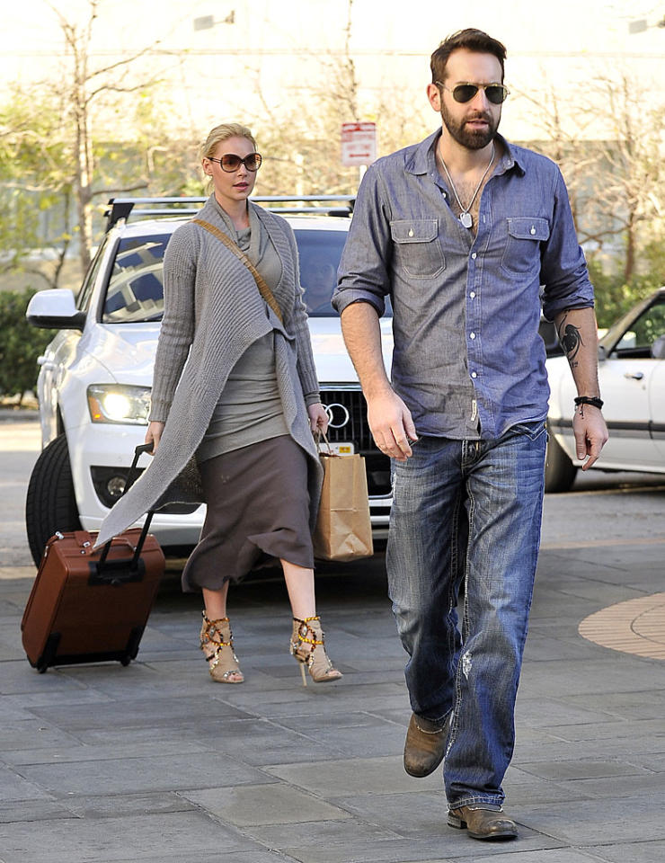 "Katherine Heigl and her husband Josh Kelley left their daughter Naleigh at home for a parents-only overnight getaway at Shutters on the Beach in Santa Monica, California. The former ""Grey's Anatomy"" star says she and Kelly have begun the adoption process for a second child -- but have not ruled out having one biologically. (2/14/2012)"
