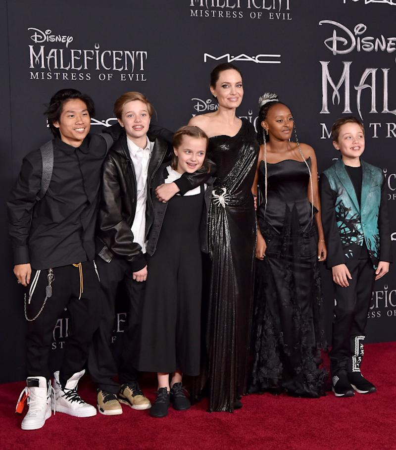 "Angelina Jolie brings her children — from left, Pax; Shiloh; Vivienne; Zahara; and Knox — to the ""Maleficent: Mistress of Evil"" premiere at El Capitan Theatre on Sept. 30 in Los Angeles. (Photo: Axelle/Bauer-Griffin/FilmMagic)"