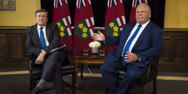 Toronto Mayor John Tory, left, and Ontario Premier Doug Ford meet inside the Premier's office at Queen's Park in Toronto on July 9, 2018.