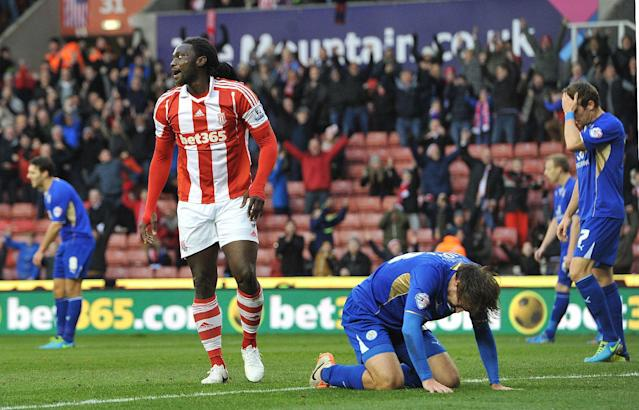Stoke City's Kenwyne Jones, center left, celebrates scoring his team's opening goal against Leicester City during their FA Cup Third Round match at the Britannia Stadium, Stoke On Trent, England, Saturday, Jan. 4, 2014. (AP Photo/PA, Dave Howarth)