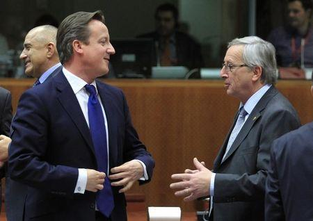 Britain's PM Cameron talks with Luxembourg's PM Juncker during EU leaders summit in Brussels