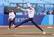 """<p>Abbott routinely hits 70 miles per hour on her pitches, a velocity almost impossible to catch up to when it comes from a pitching mound only 43 feet away - and from a pitcher whose long stride brings her even closer than that. For comparison, a 72 mph pitch in softball is about the <a href=""""https://www.espn.com/espnw/news-commentary/story/_/id/13429372/how-monica-abbott-one-softball-best-pitchers-just-continues-get-better"""" class=""""link rapid-noclick-resp"""" rel=""""nofollow noopener"""" target=""""_blank"""" data-ylk=""""slk:equivalent of a blistering 101 mph pitch in baseball"""">equivalent of a blistering 101 mph pitch in baseball</a>. According to former Team USA teammate Jessica Mendoza, now an NBC commentator at the Tokyo Olympics (and a baseball analyst for ESPN), Abbott is """"<a href=""""https://www.teamusa.org/News/2021/July/22/Monica-Abbott-Brings-The-Heat-As-Team-USA-Remains-Undefeated-In-Softball"""" class=""""link rapid-noclick-resp"""" rel=""""nofollow noopener"""" target=""""_blank"""" data-ylk=""""slk:one of the hardest-throwing pitchers"""">one of the hardest-throwing pitchers</a> in the entire game."""" That speed benefits Abbott in multiple ways; she can blow fastballs past hitters, only to leave them whiffing on her much slower changeup.</p>"""