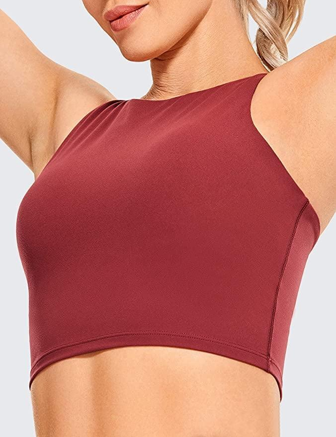 """<p><strong> The bra: </strong> <span>CRZ YOGA Women's High Neck Longline Sports Bra</span> ($24) </p> <p><strong> The rating: </strong> 4.3 stars, over 1,00 ratings</p> <p><strong> Why People Love It: </strong> This bra has a breathable, sweat-wicking fabric that is super stretchy and soft. The high neck provides coverage with a stylish design in the back. It comes in a variety of flatter colors. This reviewer loved that it's a crop top and a sports bra in one. """"This sports bra is amazing and is just what I needed. It has the pads underneath for support and then a soft extra layer overtop that fits like a crop top, so that you're not overexposed! This is perfect for going to the gym or working out in public if you don't feel comfortable wearing only a sports bra, but want to wear something small and light!""""</p>"""