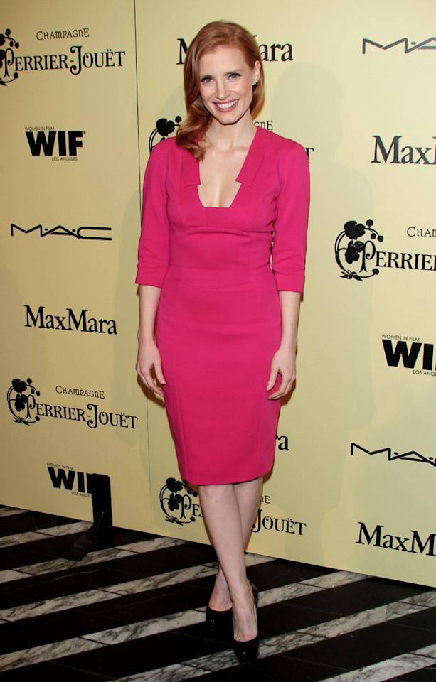 Oscars 2012 Pre Party: Jessica Chastain wowed in bright pink at the Women in Film Pre-Oscar Cocktail Party.