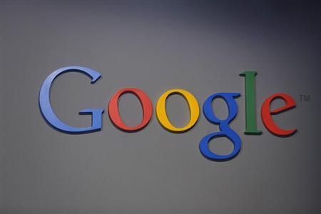 A Google logo is seen at the garage where the company was founded on Google's 15th anniversary in Menlo Park, California