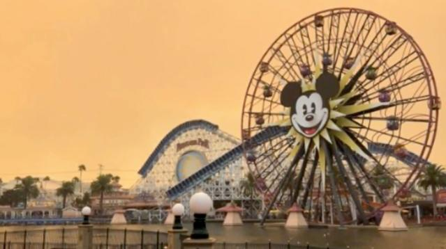Wildfires raging in Anaheim Hills turned the skies over Disneyland an ominous shade of orange on Monday.