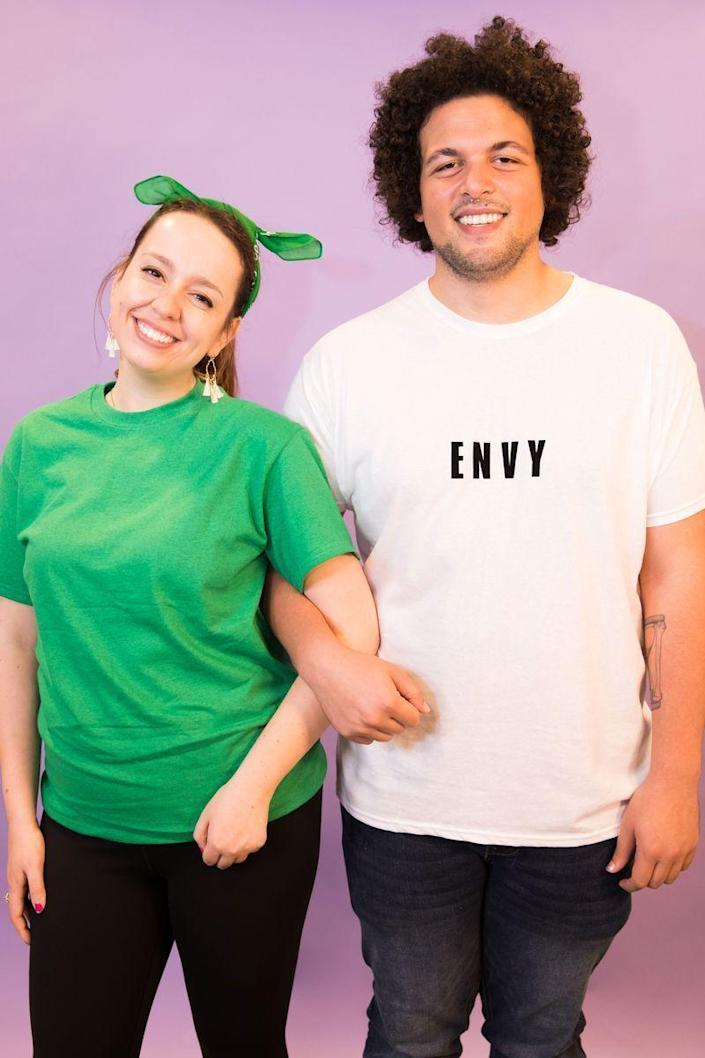 """<p>Be the punniest pair at the party with this last-minute costume, which only requires a green t-shirt and a white t-shirt printed with the word """"envy."""" </p><p><a class=""""link rapid-noclick-resp"""" href=""""https://www.amazon.com/Goodthreads-Short-Sleeve-Crewneck-Cotton-T-Shirt/dp/B07NBBVJR9?tag=syn-yahoo-20&ascsubtag=%5Bartid%7C10070.g.1923%5Bsrc%7Cyahoo-us"""" rel=""""nofollow noopener"""" target=""""_blank"""" data-ylk=""""slk:SHOP GREEN T-SHIRT"""">SHOP GREEN T-SHIRT</a></p><p><a class=""""link rapid-noclick-resp"""" href=""""https://www.amazon.com/Goodthreads-Short-Sleeve-Crewneck-Cotton-T-Shirt/dp/B06XWG4WRN?tag=syn-yahoo-20&ascsubtag=%5Bartid%7C10070.g.1923%5Bsrc%7Cyahoo-us"""" rel=""""nofollow noopener"""" target=""""_blank"""" data-ylk=""""slk:SHOP WHITE T-SHIRT"""">SHOP WHITE T-SHIRT</a></p>"""