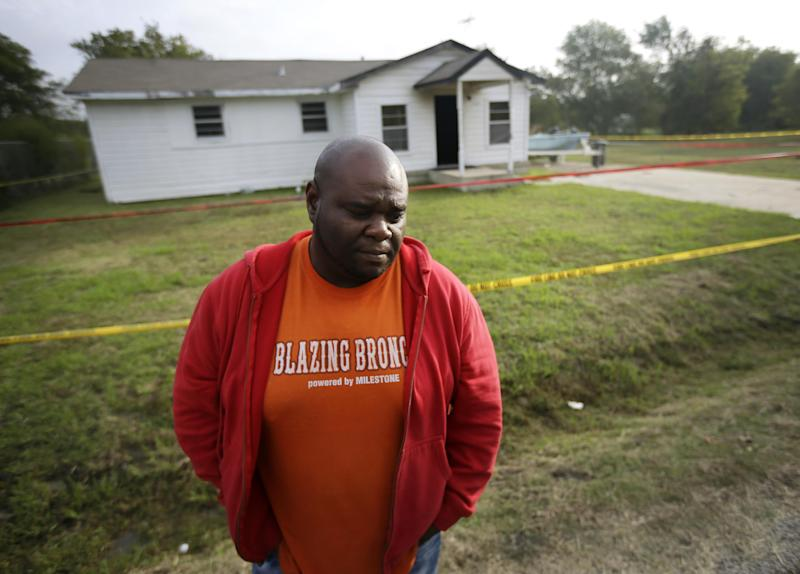 Terrence Walker of Forney, Texas, the brother of 36-year-old Charles Everett Brownlow Jr., stands in front of their mother's house as he answers a reporter's question, Tuesday, Oct. 29, 2013, in Terrell, Texas. Police arrested Brownlow early Tuesday, as he is suspected of killing five people, including his mother, during a series of attacks hours earlier in the rural North Texas community. (AP Photo/Tony Gutierrez)