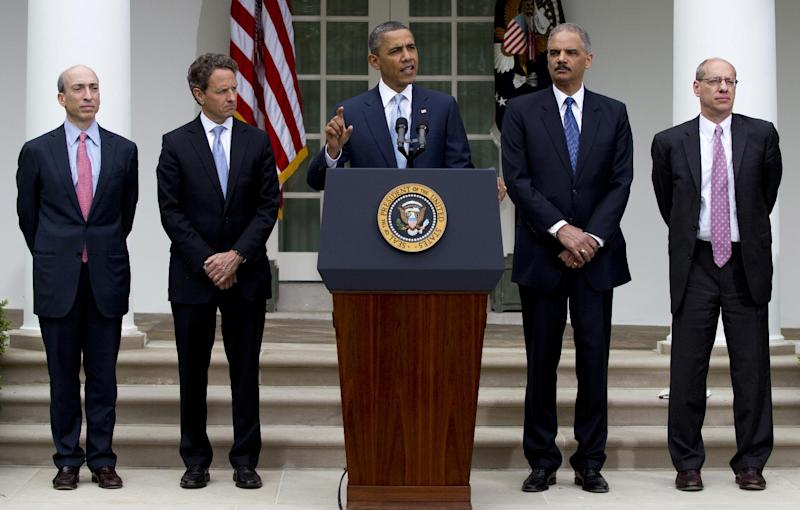 President Barack Obama speaks in the Rose Garden of the White House in Washington, Tuesday, April 17, 2012, about a plan to increase oversight and crack down on manipulation in oil markets. From left are, FTC Chairman Jon Leibowitz, Treasury Secretary Timothy Geithner, the president, Attorney General Eric Holder, and Commodity Futures Trading Commission (CFTC) Chairman Gary Gensler. (AP Photo/Carolyn Kaster)