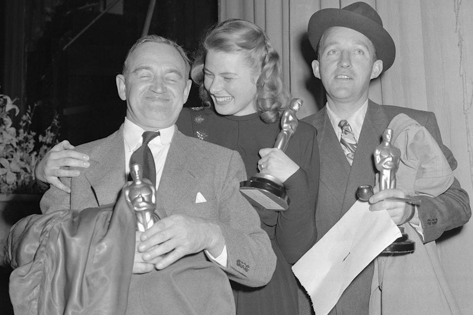 "<p>Ingrid Bergman, Barry Fitzgerald, and <a href=""https://www.goodhousekeeping.com/holidays/christmas-ideas/g2997/white-christmas-movie-facts/"" rel=""nofollow noopener"" target=""_blank"" data-ylk=""slk:Bing Crosby"" class=""link rapid-noclick-resp"">Bing Crosby</a> took photos together after winning for <em><a href=""https://www.amazon.com/dp/B000N6KC72?ref=sr_1_1_acs_kn_imdb_pa_dp&qid=1547576470&sr=1-1-acs&autoplay=0&tag=syn-yahoo-20&ascsubtag=%5Bartid%7C10055.g.5132%5Bsrc%7Cyahoo-us"" rel=""nofollow noopener"" target=""_blank"" data-ylk=""slk:Going My Way"" class=""link rapid-noclick-resp"">Going My Way</a></em> (Bing and Barry) and <em>Gaslight</em> (Ingrid). <em><a href=""https://www.amazon.com/dp/B000N6KC72?ref=sr_1_1_acs_kn_imdb_pa_dp&qid=1547576470&sr=1-1-acs&autoplay=0&tag=syn-yahoo-20&ascsubtag=%5Bartid%7C10055.g.5132%5Bsrc%7Cyahoo-us"" rel=""nofollow noopener"" target=""_blank"" data-ylk=""slk:Going My Way"" class=""link rapid-noclick-resp"">Going My Way</a></em> nabbed seven major Oscars that night including Best Picture and Best Director (Leo McCarey).</p>"