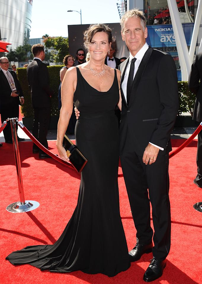 From left, Chelsea Field and Scott Bakula arrive at the 2013 Primetime Creative Arts Emmy Awards, on Sunday, September 15, 2013 at Nokia Theatre L.A. Live, in Los Angeles, Calif. (Photo by Scott Kirkland/Invision for Academy of Television Arts & Sciences/AP Images)
