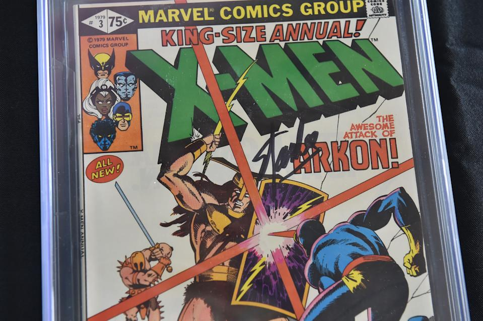 """A Stan Lee-signed copy of the 1979 """"X-Men Annual #3"""" is displayed at Julien's Auctions in Beverly Hills, California, on November 13, 2018. - The comic book is part of a selection of 20 works associated with Lee's comics universe which will be sold November 16-17 at Julien's Auctions' Beverly Hills gallery and online. Stan Lee, who was the editor-in-chief of Marvel Comics, died November 12 in Los Angeles at age 95. (Photo by Robyn Beck / AFP)        (Photo credit should read ROBYN BECK/AFP/Getty Images)"""