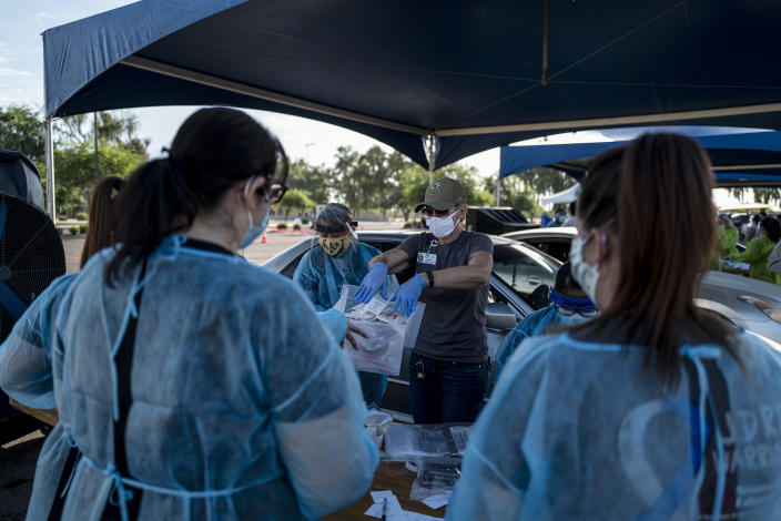 Testing for the coronavirus at a drive-thru testing site in Phoenix, Ariz., on Saturday, June 27, 2020. (Adriana Zehbrauskas/The New York Times)