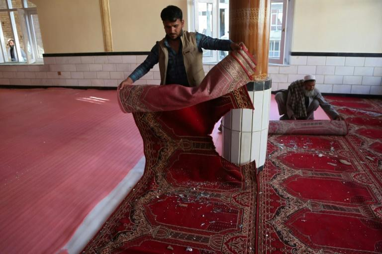 At least 12 people were killed in a mosque blast on the outskirts of Kabul, shattering the calm on the second day of a ceasefire between the Taliban and government