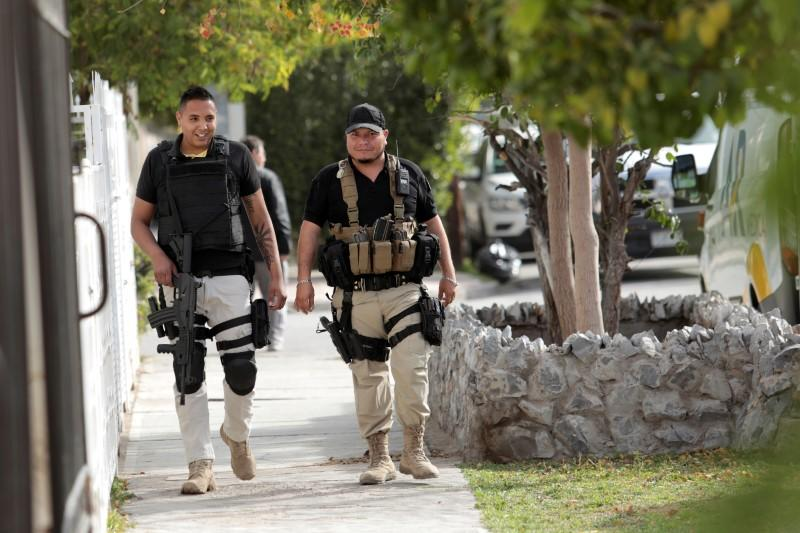 Policemen patrol the perimeter of a private school after a boy shot a teacher and wounded several students, in Torreon
