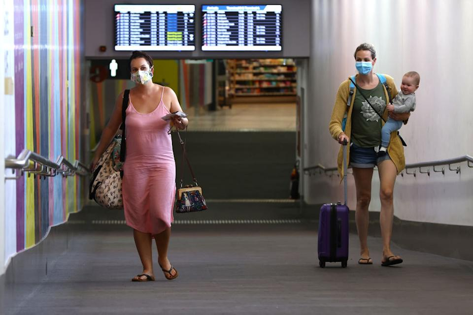 Australia's borders are likely to remain closed until mid 2022, but lower vaccination rates mean inevitable case surges. Source: Getty