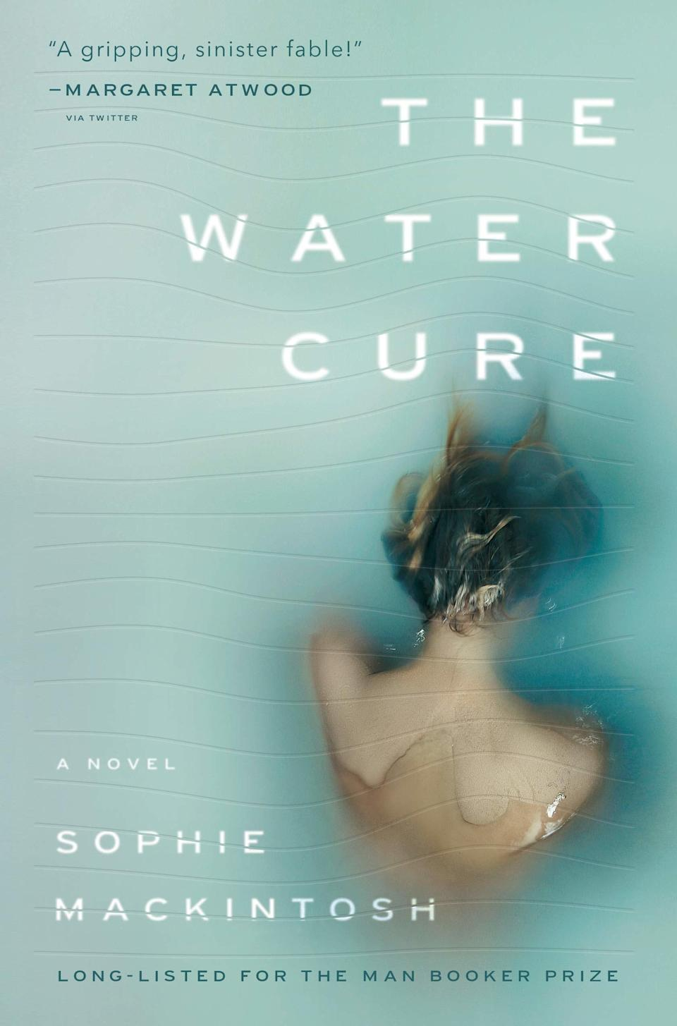 """<em>The Water Cure</em> has drawn instant comparisons to <em><a href=""""https://www.glamour.com/story/the-handmaids-tale-max-minghella-on-his-character-nick?mbid=synd_yahoo_rss"""" rel=""""nofollow noopener"""" target=""""_blank"""" data-ylk=""""slk:The Handmaid's Tale"""" class=""""link rapid-noclick-resp"""">The Handmaid's Tale</a>,</em> and not just because author Margaret Atwood called it """"a gripping, sinister fable."""" The book centers on Grace, Lia, and Sky, three sisters who live on an isolated island with their mother and their father, whom they call King. When their father disappears, their lives—as well as everything they've been told about the outside world—are upended."""