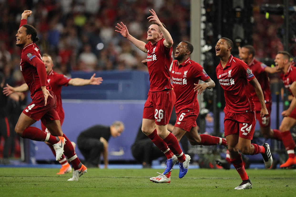 MADRID, SPAIN - JUNE 01: Andrew Robertson of Liverpool and teammates celebrate after winning the champions league final after the UEFA Champions League Final between Tottenham Hotspur and Liverpool at Estadio Wanda Metropolitano on June 1, 2019 in Madrid, Spain. (Photo by Matthew Ashton - AMA/Getty Images)