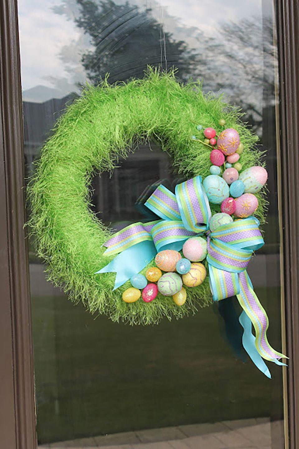"""<p>You won't be able to keep your hands off this fuzzy, colorful wreath!</p><p><strong>Get the tutorial at <a href=""""http://misskopykat.blogspot.com/2012/03/grass-wreath.html"""" rel=""""nofollow noopener"""" target=""""_blank"""" data-ylk=""""slk:Miss Kopy Kat"""" class=""""link rapid-noclick-resp"""">Miss Kopy Kat</a>. </strong></p><p><strong><a class=""""link rapid-noclick-resp"""" href=""""https://www.amazon.com/s?k=easter+grass&i=garden&ref=nb_sb_noss_2&tag=syn-yahoo-20&ascsubtag=%5Bartid%7C10050.g.4088%5Bsrc%7Cyahoo-us"""" rel=""""nofollow noopener"""" target=""""_blank"""" data-ylk=""""slk:SHOP EASTER GRASS"""">SHOP EASTER GRASS</a></strong></p>"""