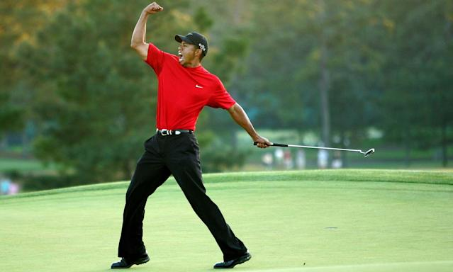 Tiger Woods celebrates after sinking a putt to win The Masters in 2005. (Getty)